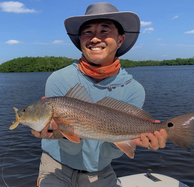 Jon Yenari of Sarasota caught this redfish on a D.O.A. Lures CAL jig and Shad Tail while fishing in Gasparilla Sound with Capt. Rick Grassett recently.