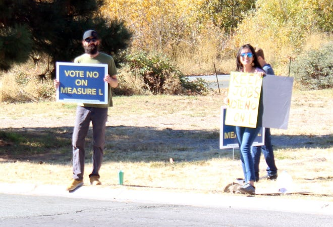 Reny Townsend and Bianca Garza stand outside the polling place at the Mount Shasta Community Building on Tuesday afternoon to encourage people to vote no on Measure L.