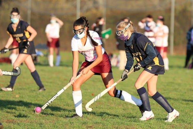 Tiverton's Angelin Santerre, left, attempts to keep the bal away from a Burrillville defender on Wednesday afternoon.