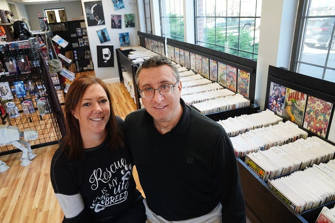 Owners Taryn Forbes and Rich Reina show some of the new inventory available at Miller's Comics, Cards, Collectables, and Toys in North Hampton.