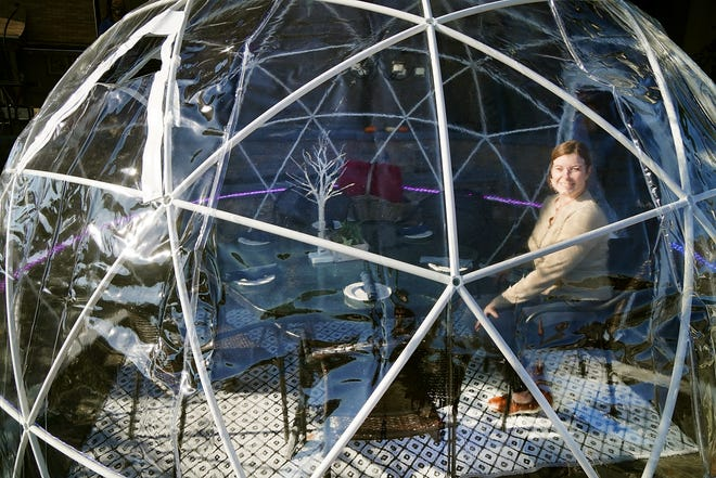 Kati Pittendreigh, manager at The Galley Hatch in Hampton, shows the new igloo added for outdoor dining, complete with heat and vented for proper air circulation.