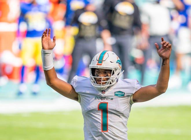 Dolphins quarterback Tua Tagovailoa celebrates his first touchdown pass, to DeVante Parker against the Rams.
