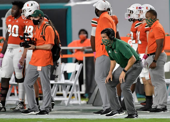 Miami coach Manny Diaz watches his team closely during its 19-14 win over Virginia on October 24.