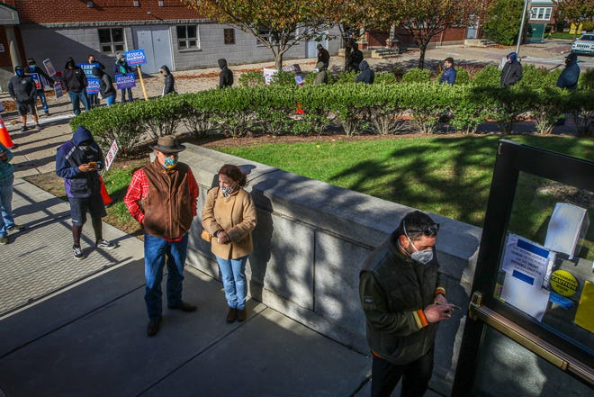 Early voting at Cranston City Hall had lines running to the parking lot.  [The Providence Journal / David DelPoio]