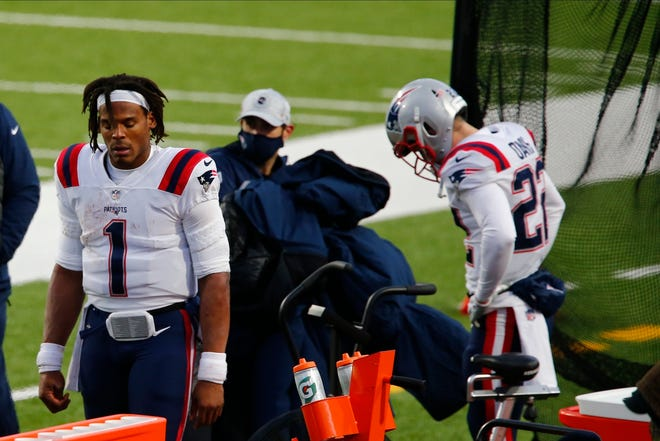 Patriots quarterback Cam Newton reacts after fumbling the ball during the second half of Sunday's game against the Bills. Next up for the Patriots are the winless Jets on Monday night.