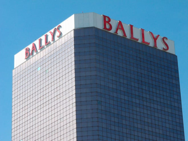 "This Oct. 1, 2020, photo shows the exterior of Bally's casino in Atlantic City, N.J. On Nov. 4, 2020, officials with Twin River Worldwide Holdings, a Rhode Island firm that's buying Bally's for $25 million, said they can make it ""a place to see and be seen"" by investing $90 million into the aging casino and boosting its offerings. (AP Photo/Wayne Parry)"