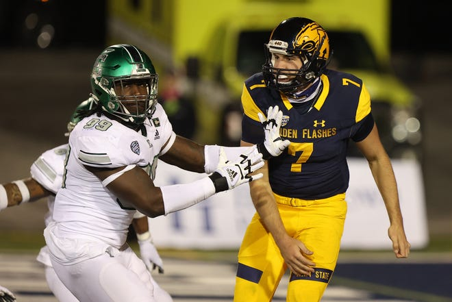 Kent State senior quarterback Dustin Crum unleashes a pass during Wednesday's night's battle against Eastern Michigan at Dix Stadium.