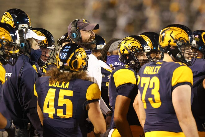 Kent State head coach Sean Lewis with his team at kickoff against Eastern Michigan Wednesday night at Dix Stadium.