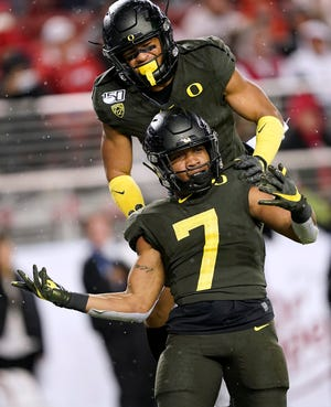 Running back CJ Verdell (7) and wide receiver Johnny Johnson III are back to lead the Oregon offense.