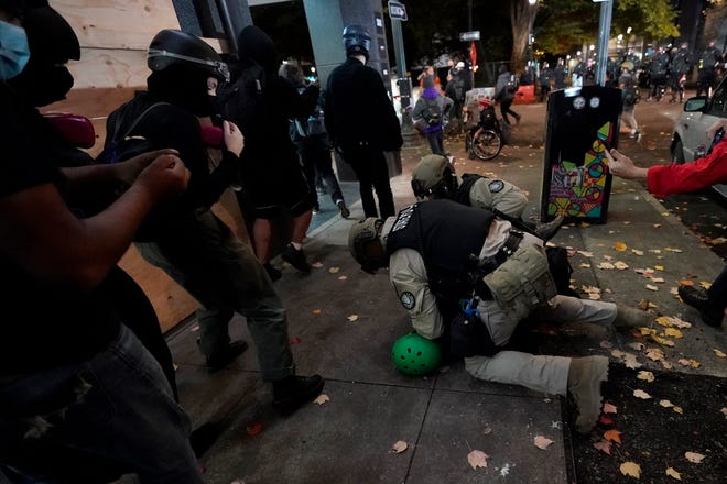 Oregon State Police arrest a protester in Portland Wednesday, Nov. 4, following Tuesday's election.