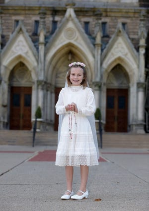 Cagney Black, 8, will wear her great-great grandmother Helen Lindenberger Rohr's 109-year-old communion dress when she makes receives the sacrament Saturday at St. Mary Catholic Church in Massillon.