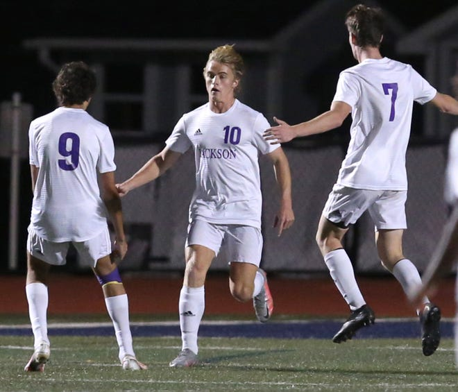 Garrett Hattery (10) of Jackson celebrates his goal with Nick Fahmy (9) and Ryan Buckler (7) duirng their Division I regional semifinal game at Hudson on Wednesday.