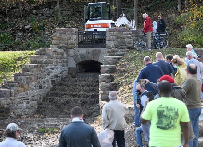 A ceremony Thursday for the Monument Pond Restoration Project in Canton included the start of water flowing to refill the pond.