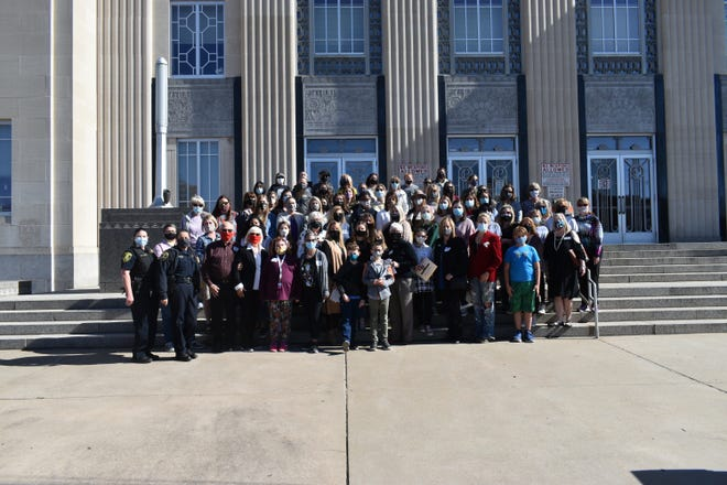 All who walked in the RBG event standing in front of the Pottawatomie County Courthouse.