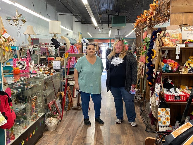 Owners of Past to Present Marketplace Tammy Alexander and Holly Ross standing in their store located at 7 W. Main Street.