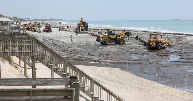 Heavy equipment operates along the southern area of North Topsail Beach in 2015 as part of a beach nourishment project.