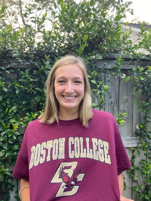 Cape Fear Academy's Liza Murtagh poses in her Boston College shirt after committing to swim with the Eagles  this summer.