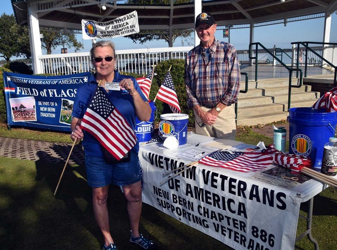 Donna Baker of New Bern donated four flags to honor family members who were in military service. The Field of Flags opens at Union Point Park on Nov. 6 and remains through Nov. 12. Rick Miller is president of the sponsoring Vietnam Vieterans of American, Chapter 886.