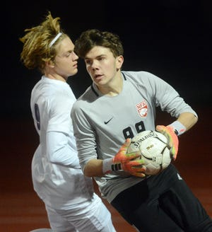 NFA goalie Logan Swan runs the ball around Waterford's Matias Arcelus Wednesday during Waterford's 4-1 win in Norwich.