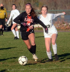 Plainfield's Angelina Giovanni and Griswold's Lilly Morano battle for the ball during their game in Plainfield.