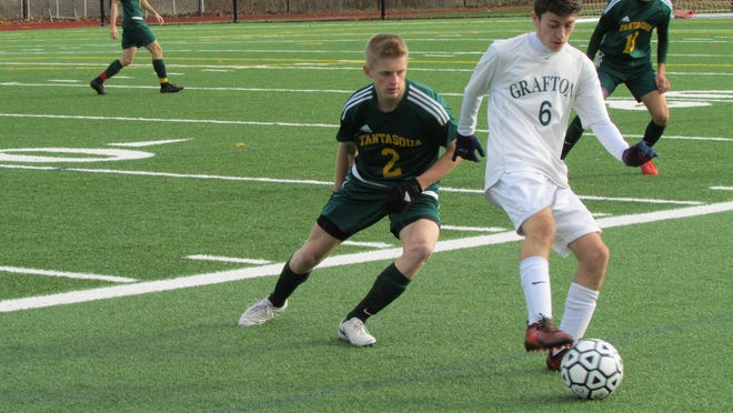 Tantasqua's Ethan Eroh defends during a game in 2018.