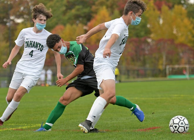 Clinton's Pedro Almeeida de Costa battles for control of a loose ball with Tahanto's Charlie Stille, left, and Anthony Zapelli during a game earlier this season.