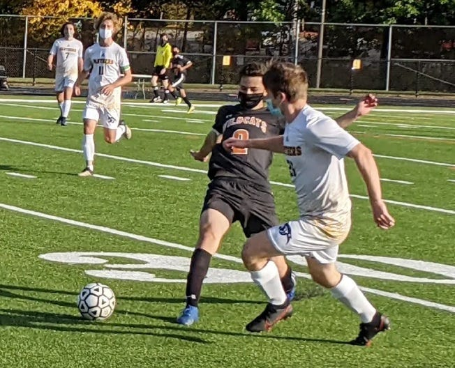 Quabbin senior William Ordung, right, plays a short corner kick in front of Gardner defender Henry Aguilar during a game earlier this season.