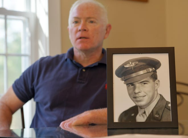 Andrew Redgate on Thursday at home in Uxbridge with a picture of his uncle, who served in the Korean War. The remains of 1st Lt. Thomas J. Redgate have been returned to the family.