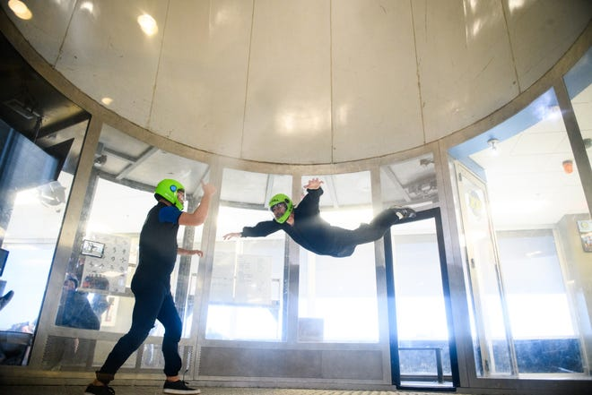 Reporter Rodger Mullen takes instructions from David Nance while indoor skydiving at Paraclete XP.