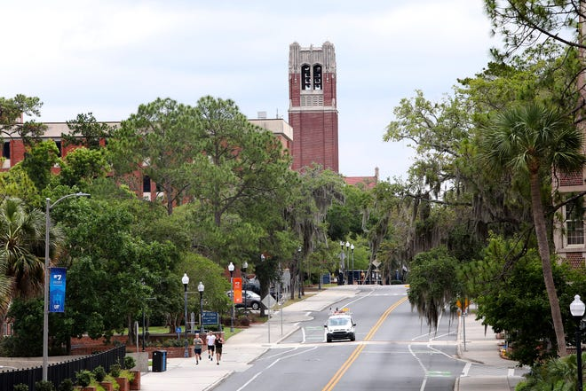 Century Tower on Stadium Road at University of Florida campus in April, when campus was largely shut down. The university's faculty union has filed a grievance against administrators' orders to return to face-to-face classes to pre-pandemic levels by January.