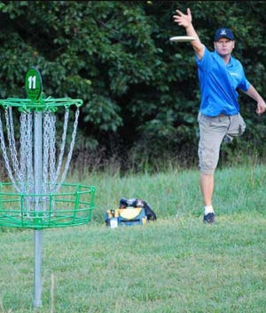 "Action from ""The Wicked Woodpecker 2020,"" the third annual tournament hosted by the Southern Woodpeckers Disc Golf Club at the Vivian Lee Maddox Sports Complex in Rainbow City. Eighty players from five states competed in 12 divisions for cash and prizes."