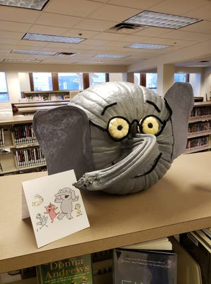 """The Newcomerstown Public Library has announced Taylor Yankovich is the winner of its pumpkin decorating contest. Taylor is the daughter of Beth Trenta and Trevor Yankovich. Taylor and her mother decorated a pumpkin found by her father in the style of """"Elephant"""" from the """"Elephant and Piggie"""" series of children's books. Trent said her daughter has a big interest in elephants and """"when I heard of this contest, I knew we could find a great pumpkin to make one of her favorite story characters come to life."""" She noted the eyes are also small pumpkins."""