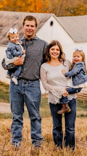 Jake Conner (left) holds Josie, while Ashley Conner holds Mary.