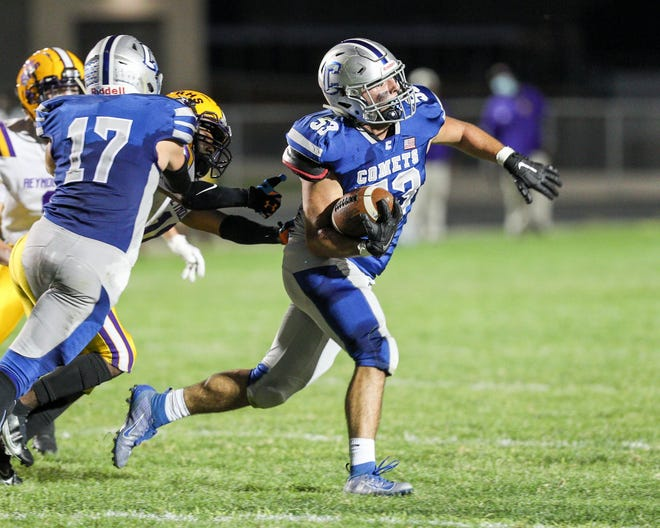 Linebacker Max Webb, who heads upfield after making an interception against Reynoldsburg, is expected to be one of the top returnees for the Comets, who finished 2-7.