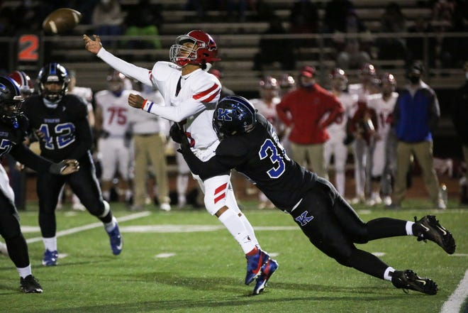 Kilbourne's Bryce Taylor hits Thomas quarterback Caleb Ortega as he attempts to pass during their season-closing game Oct. 30. The host Wolves won the Worthington rivalry showdown 29-7.