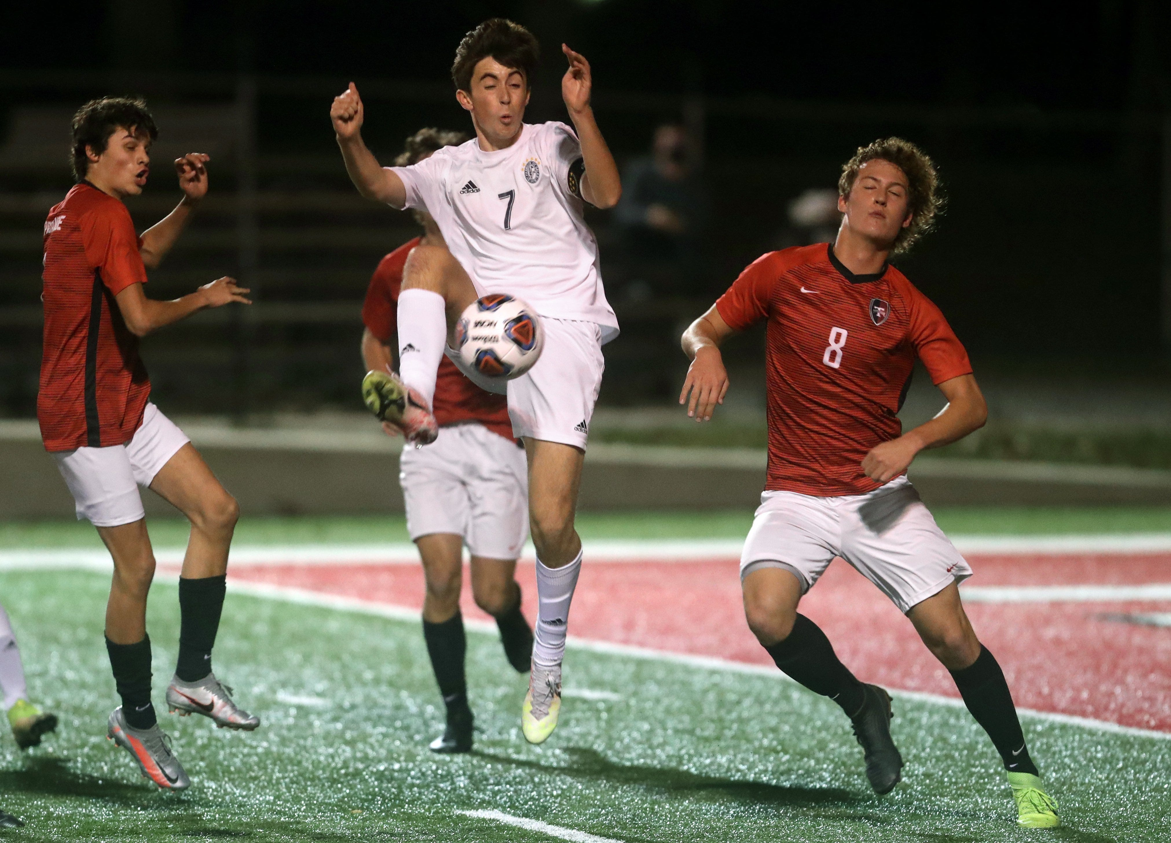 DeSales' Andrew Shaffer leaps to kick the ball away from Tipp City Tippecanoe's Jonny Baileys (8) during a Division II regional semifinal Nov. 4, 2020, at Red Devil Stadium in Tipp City, Ohio.