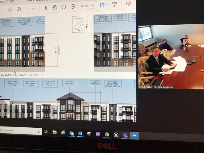 The Buncombe County Board of Adjustment unanimously approved a proposal for 852 apartments and 10 single family homes, called the Busbee project, off Sweeten Creek Road. The meeting was held virtually, and here, civil engineer Will Buie, who works for the development company, offers testimony about building structure and heights.