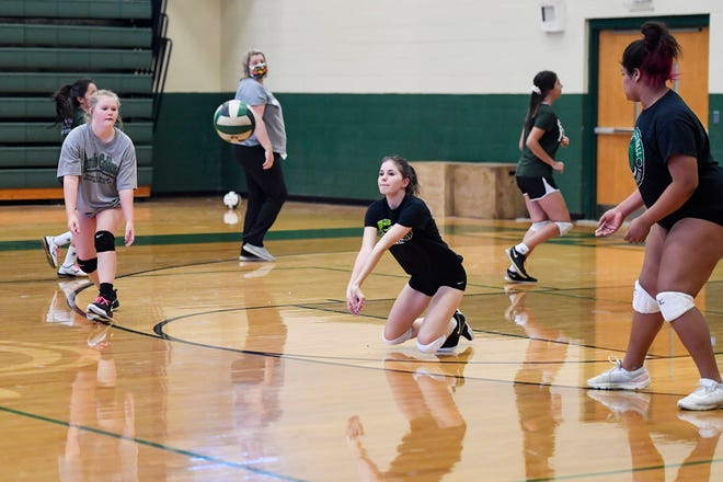 The East Henderson volleyball teams works out on Wednesday, the first day of practice after delays caused by the coronavirus pandemic.