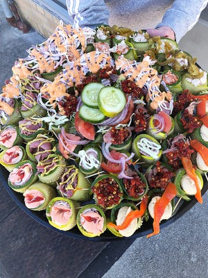 An Elsie's party platter offers a host of pickle and cucumber roll-ups from the Haddon Township cafe. The business, which made a splash with its breadless sandwiches, is now offering franchises to perspective entrepreneurs.