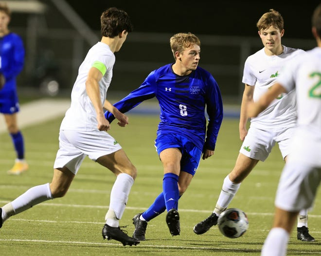 Saint Xavier midfielder Brent Lands looks to pass in the boys soccer match between Sycamore and Saint Xavier high schools Nov 4, 2020