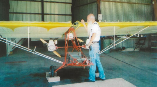 """Gerald """"Jerry"""" Schleis, seen here in this 2010 photo with an ultralight airplane, is remembered for his kindness, his adventures and his many skills. Schleis died Sept. 13 of COVID-19"""
