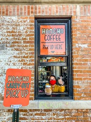 Honcho team member Michaela Weaver poses for a photo through the Clarkston restaurant's walk-up window.