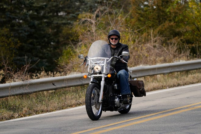 Sen. Gary Peters, D-Mich., rides his motorcycle after meeting with the media, Thursday, Nov. 5, 2020, in Rochester, Mich. Peters won reelection Wednesday, defeating Republican challenger John James in a tight, expensive race that was the state's most competitive in two decades. (AP Photo/Carlos Osorio)