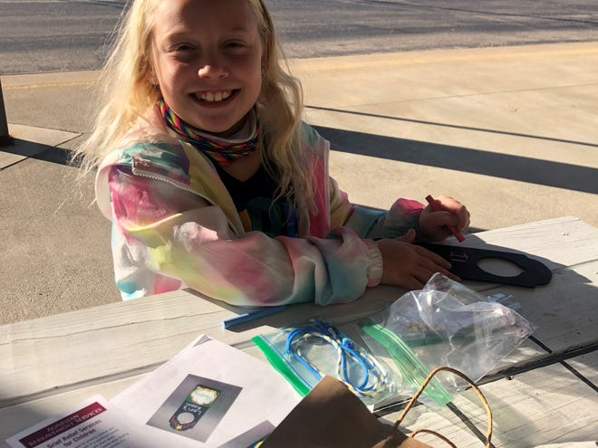 Mia Graham couldn't wait to complete her Healing Through Hope November activity kit for Children's Grief Awareness Month at the Children's Museum of Fond du Lac.