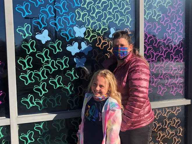 Kari Graham and her daughter Mia picked up their first Healing Through Hope November activity kit for Children's Grief Awareness Month at the Children's Museum of Fond du Lac.