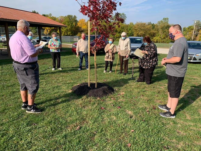 Clyde Mayor Scott Black, left, reads his Arbor Day Proclamation at Limerick Park.