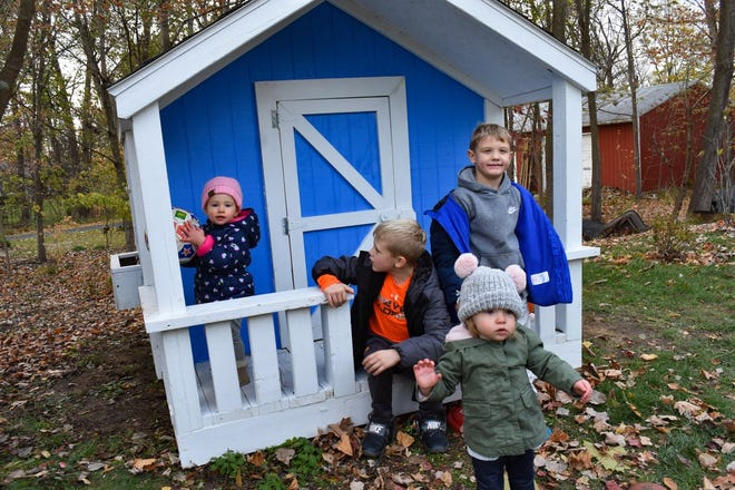 Students in Vanguard's Building Construction Trades program built 74-square-foot playhouse as a fundraiser for Sandusky County Habitat for Humanity. Sue Jenkins won the playhouse and had it set in the yard of her Fremont home where her seven grandchildren enjoy it. Shown here are, left to right in back, Rosie Ronski, Rowan Snare, and Eli Snare. In front is Reagan Myers.