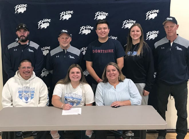 Great Falls High softball star Morgan Sunchild, surrounded by family and coaches, signs her letter-of-intent to play softball at Bellevue (Wash.) College this fall.  She is flanked by parents Chad and Marlee Sunchild, and backed up (left to right) assistant coach Travis Palmer, head coach Don Meirhoff, brother Keaton Sunchild, and assistants Sam Stevens and Bucky Lindstrand.