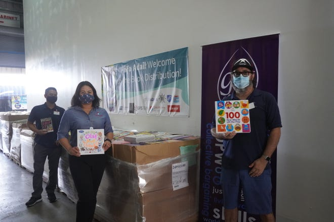 Guam Federation of Teachers receives a donation of more than 40,000 free books, which will be distributed  to students and children in Guam.
