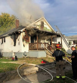 Lancaster firefighters work to extinguish the last of the flames at a house on the 700 block of Harrison Avenue. The cause of the fire is under investigation. The 911 call came shortly after 8 a.m.